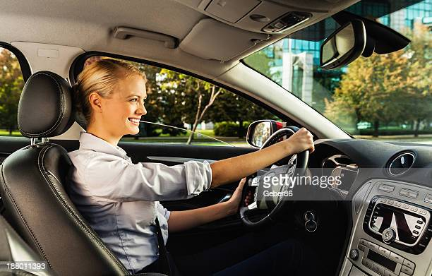 Businesswoman driving car