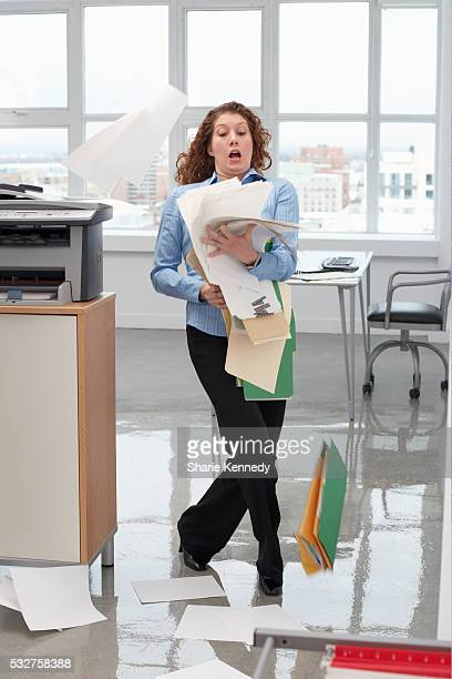 Businesswoman Dropping Papers