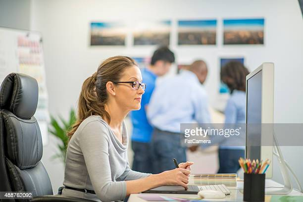 Businesswoman Editing Photographs