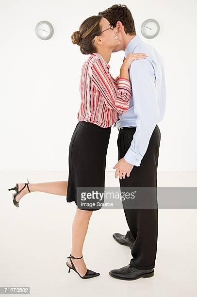 Businesswoman embracing businessman
