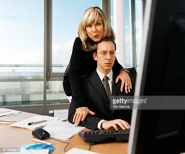 Businesswoman Embracing Man in Office
