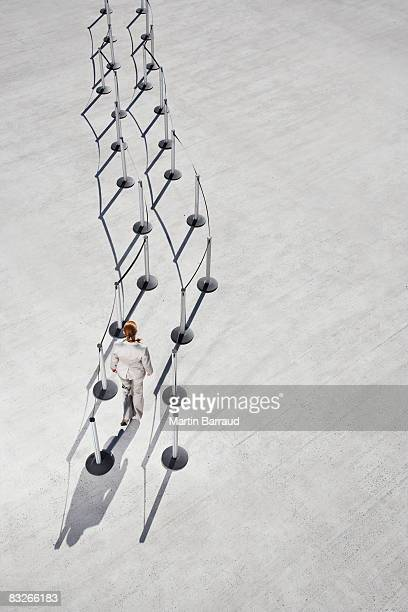 Businesswoman entering cordon posts