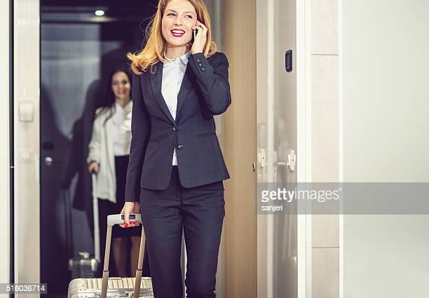 Businesswoman entering hotel room