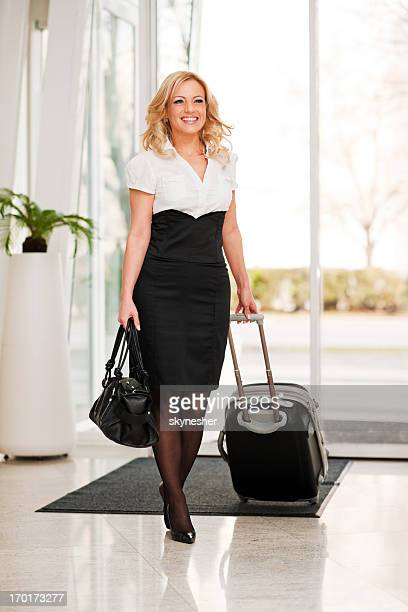 Businesswoman entering the hotel lobby.
