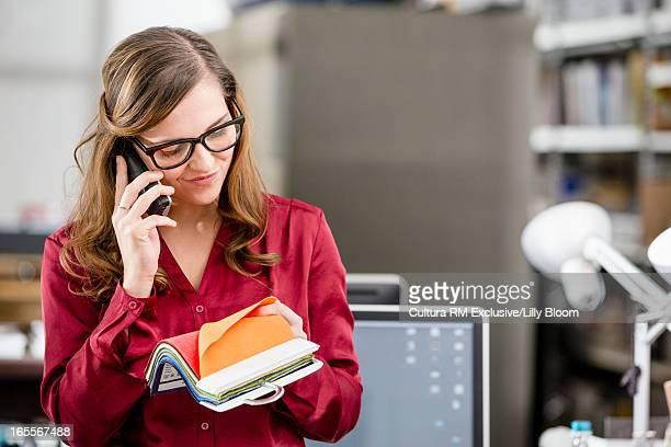 Businesswoman examining fabric swatches