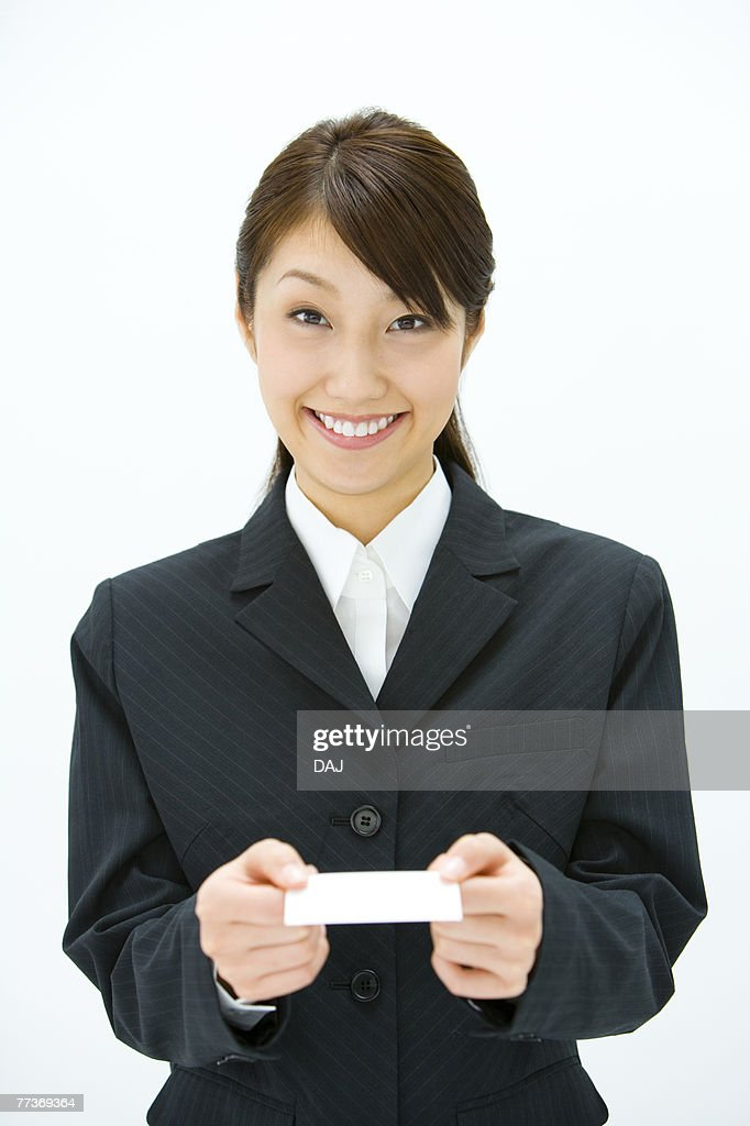 Businesswoman Exchanging Business Cards, Smiling, Three Quarter Length, Front View : Photo
