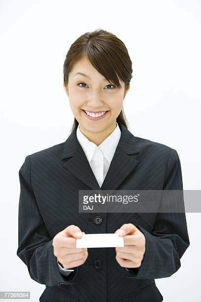 Businesswoman Exchanging Business Cards, Smiling, Three Quarter Length, Front View