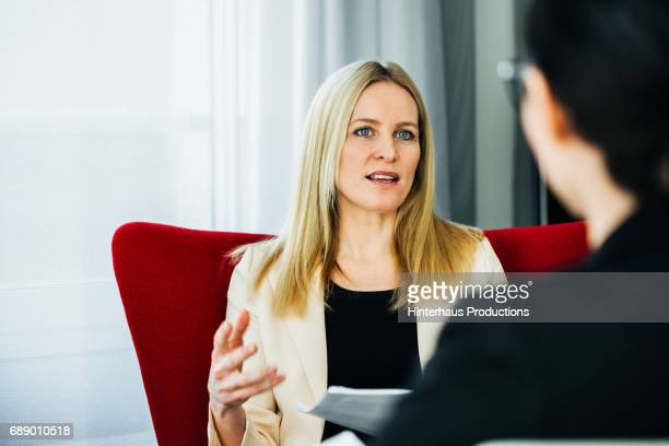 Businesswoman Exchanging Ideas With Colleagues