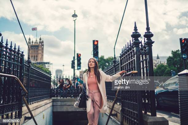 Businesswoman exiting the London subway