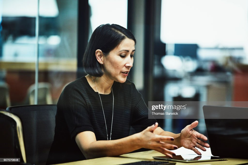Businesswoman explaining data on digital tablet during meeting in office conference room : Stock Photo