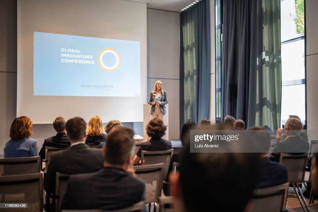 Businesswoman explaining new ideas and strategy in seminar : Stock Photo