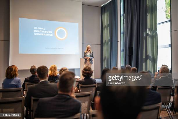 businesswoman explaining new ideas and strategy in seminar - projection screen stock pictures, royalty-free photos & images
