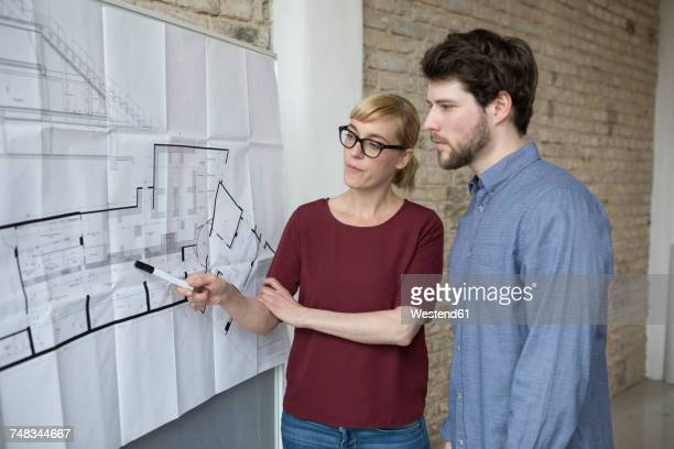 Businesswoman explaining new project to young colleague