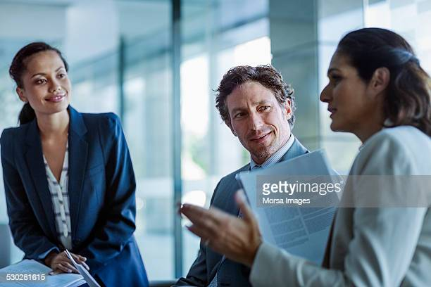 businesswoman explaining strategy to colleagues - leanintogether stock pictures, royalty-free photos & images