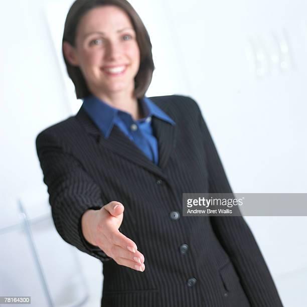 Businesswoman extending a handshake