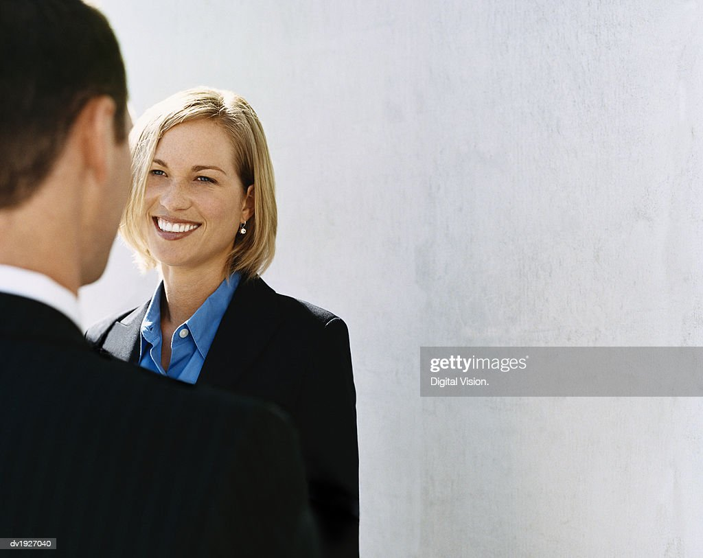 Businesswoman Face to Face With a Businessman Outdoors : Stock Photo