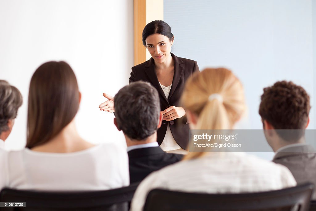 Businesswoman facilitating group discussion : Stock Photo