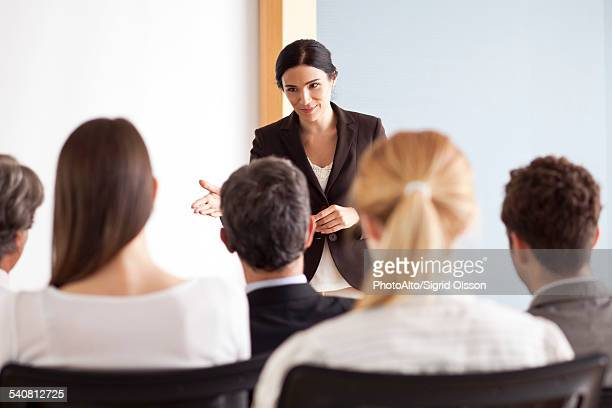 Businesswoman facilitating group discussion