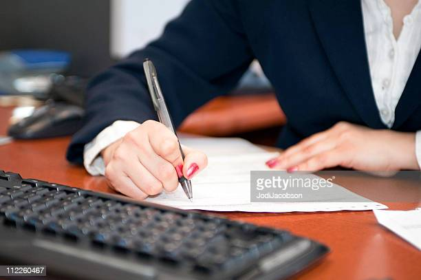 Businesswoman filling out contract