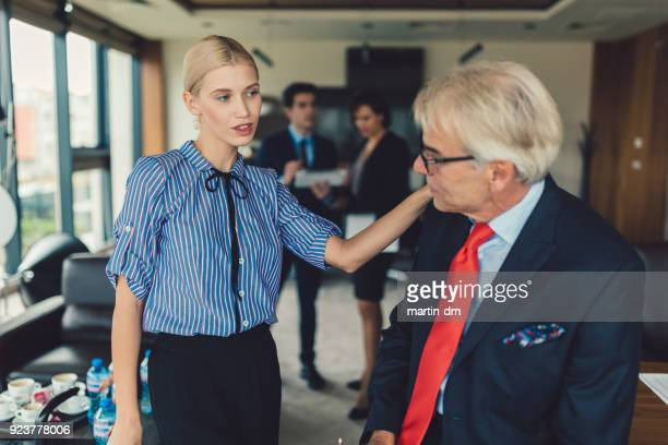 businesswoman flirting with the boss - seduction stock pictures, royalty-free photos & images