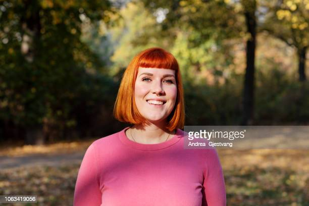 Red-haired woman in the park