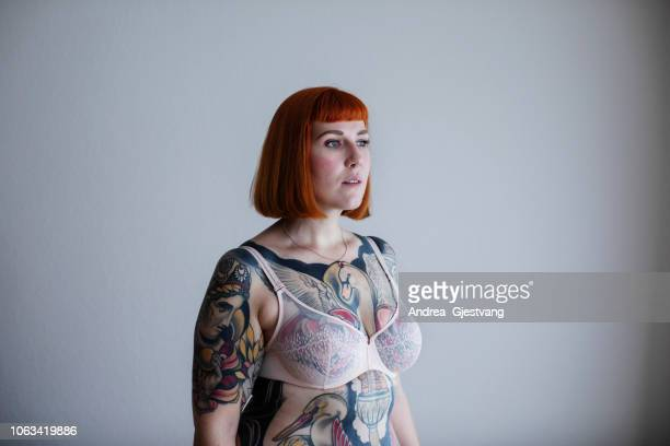 red-haired woman with full body tattoos - body piercings stock pictures, royalty-free photos & images