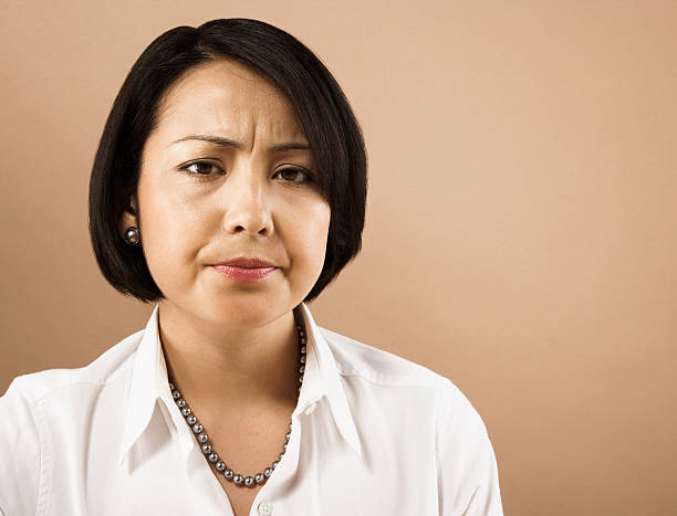 businesswoman frowning - mad asian woman stock pictures, royalty-free photos & images