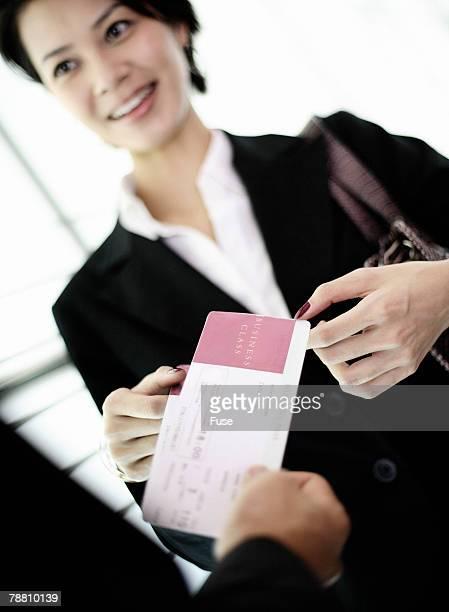 Businesswoman Getting Airline Ticket