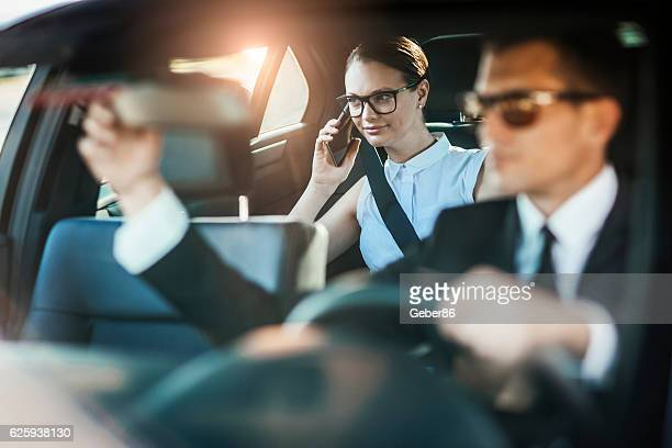 Businesswoman getting chauffeured