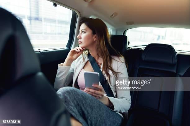 Businesswoman getting chauffeured