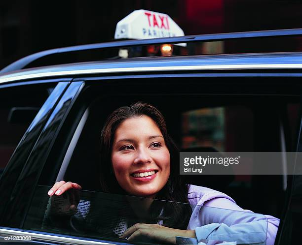 Businesswoman getting Out of a Taxi in Paris