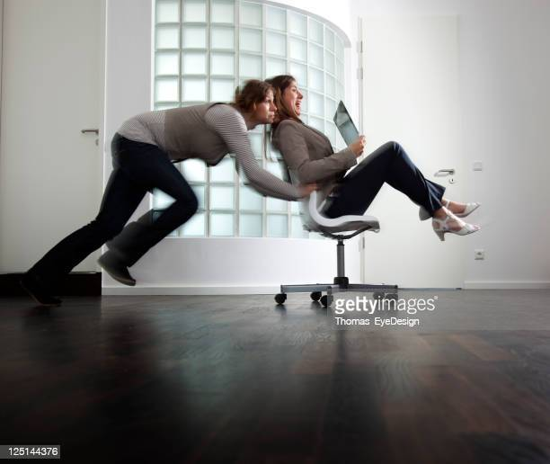 Businesswoman Getting Pushed in a Chair