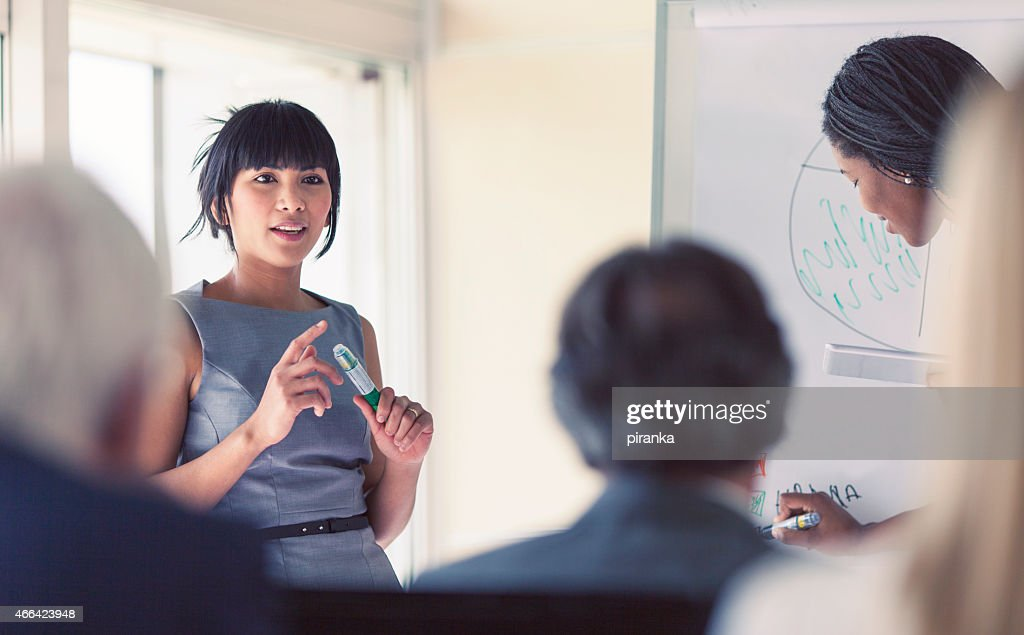 Businesswoman giving a presentation : Stock Photo