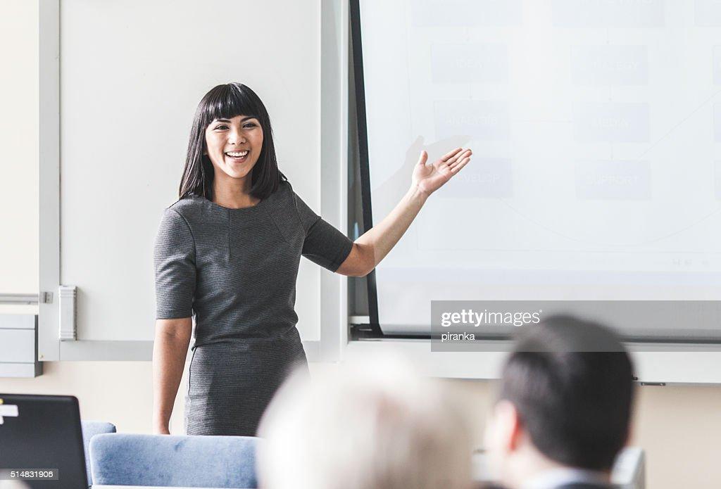Businesswoman giving a presentation : Stock Photo