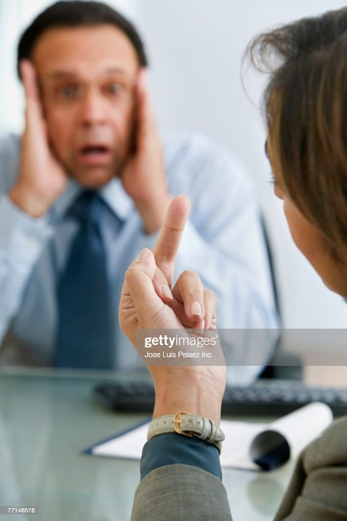 Businesswoman giving middle finger to businessman : Stock Photo