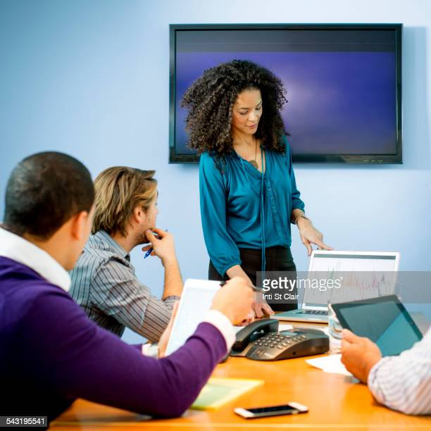 Businesswoman giving presentation in office meeting