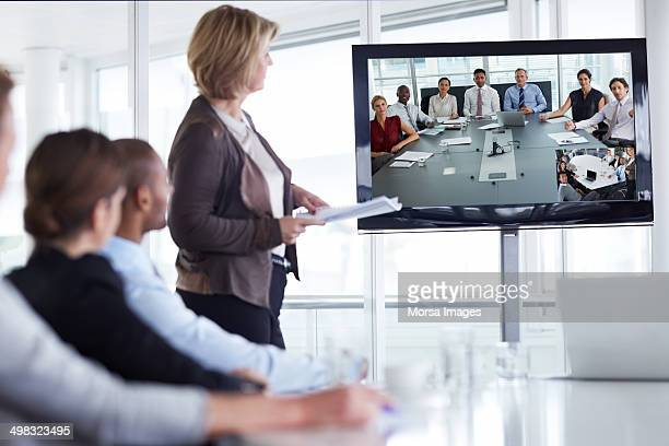 businesswoman giving presentation - video conference stock pictures, royalty-free photos & images