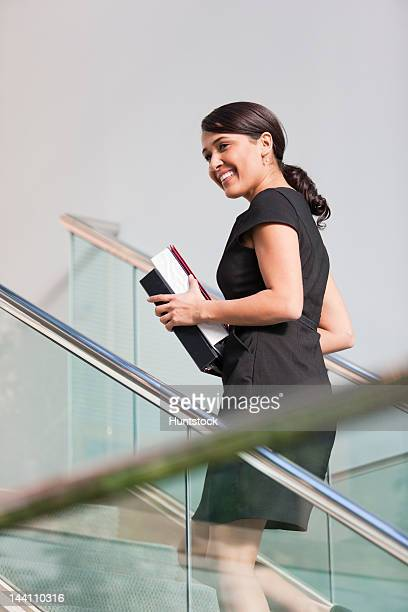 Businesswoman going up stairs of office building