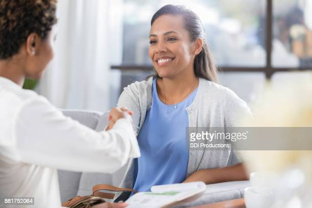 businesswoman greets client before meeting - counseling stock pictures, royalty-free photos & images