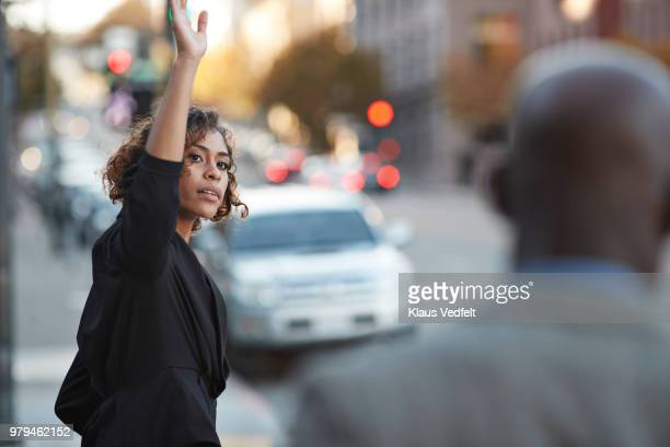 Businesswoman hailing cab on the streets of San Francisco