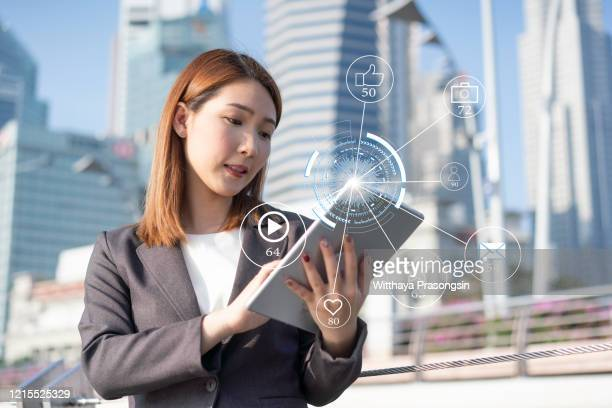 businesswoman hands using laptop with icon social media and social network, marketing concept. - customer engagement stock pictures, royalty-free photos & images