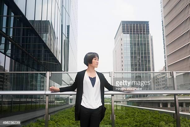 Businesswoman has a break in the rooftop garden