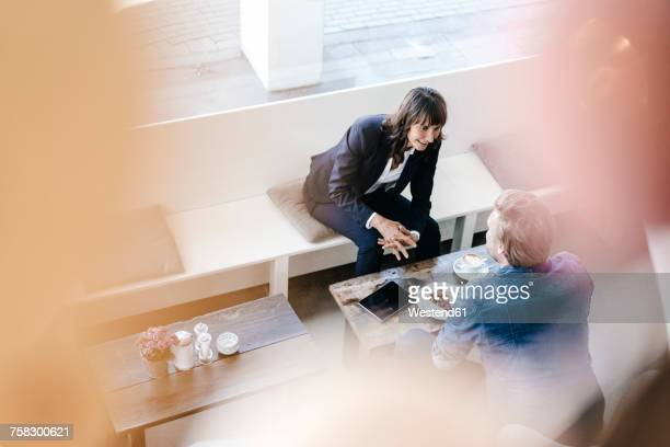 Businesswoman having a meeting with client in a cafe