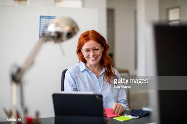 businesswoman having a video call at office - opening event bildbanksfoton och bilder