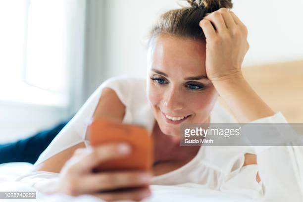 businesswoman having a video call in hotel. - bella ciao foto e immagini stock