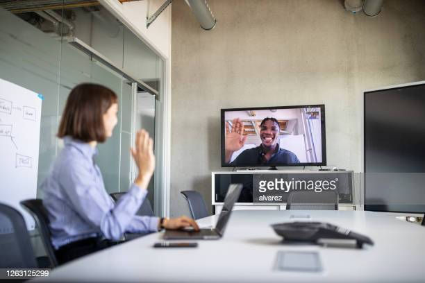 businesswoman having a video call with a colleague - remote location stock pictures, royalty-free photos & images