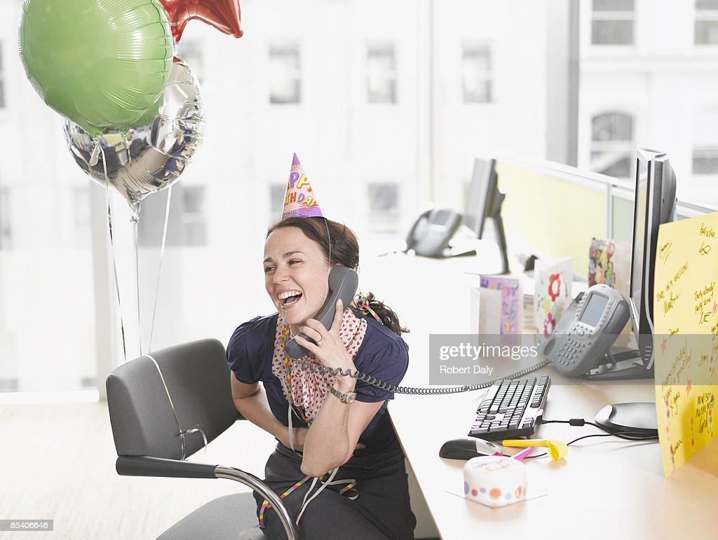 Businesswoman having birthday party at desk : Stock Photo