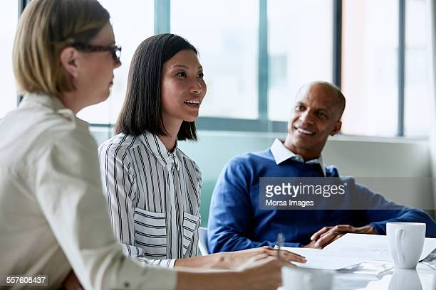 Businesswoman having discussion with colleagues