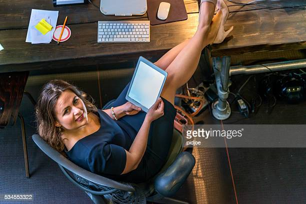 Businesswoman having internet break in office
