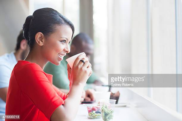 Businesswoman having lunch in cafe